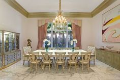 372 Regatta Drive Jupiter FL 33477 by Susanna Malmgren-Grubb RX-10006609 Intracoastal Masterpiece - This magnificent estate home has unobstructed view of Intracoastal and Wildlife Preserve. Grand foyer entrance with Large slab marble floors, custom wood ceiling, Venetian plaster, extensive wood working, no expense was spared. 5 Bedrooms all with private full baths, including a fully equipped guest house with mini kitchen. The moment you enter the drive you know you have entered paradise. ...