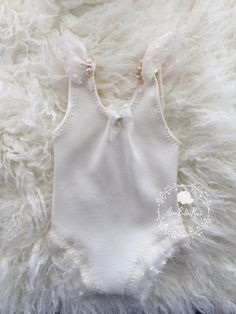 Pixie Romper / Romper CollectionSize | NewbornColor | Cream Details | Gorgeous silk romper with hand beaded natural pearls Care | Hand wash lay flat to dryNote | Product intended as a photo prop. Do not leave baby unattended.Photo | Ama Bella Rosa