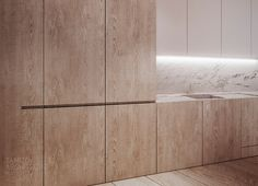 the slit is there to give the horizontality to continue with the counter top, and also provide areas from where you can open the cabinets