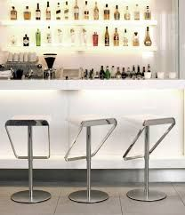 White home bar with neat drinks display to add interest to an otherwise minimalist design.
