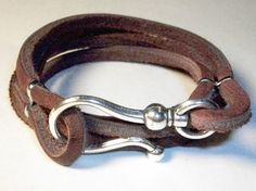 leather bracelet - if I made and wore this everyone would wonder why I had a dog eash on my arm