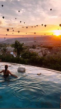 Swimming pool with a view of sunrise in Cappadocia with hot air balloons - Museum hotel, Uchisar - photo by @museumhotel via Instagram for 10 Beautiful spots in Cappadocia that are Instagram worthy on DrifterPlanet.com