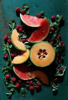 This would make a great melon fruit salad mix: Watermelon, Cantaloupe, Raspberries and mint. Add a little honey and lime juice and you're set!