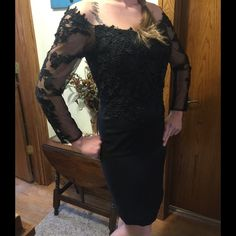 👠 Mac Duggal black dress NWOT💋 NWOT Drop Dead Gorgeous Designer Black Dress!! Fits like a 6, the label says size 12.  I bought it to wear to my daughter's wedding, I'm a pear shaped size US 10/12 and couldn't get it on.  I wanted to cry because it is so beautiful.  My niece, who is modeling the dress is a US 6/8.  The quality of the lace is outstanding.  When you wear it you'll look outstanding!  To ensure it fits 'you' please ask as many questions as you'd like!! Mac Duggal Dresses