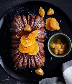 Mandarin and ginger syrup cake recipe - Preheat oven to and butter and flour a x loaf tin (we used a fluted loaf tin). Place mandarins in a saucepan Ginger Syrup, Ginger Sauce, Sweet Recipes, Cake Recipes, Dessert Recipes, Syrup Recipes, Citrus Recipes, Yummy Recipes, Gourmet
