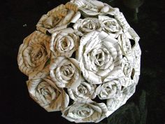 vintage book pages recycled paper rose bouquet for weddings, bridesmaids, toss bouquet from a Harry Potter book. $75.00, via Etsy.