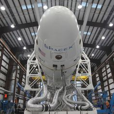 This is a picture of the DragonX spacecraft in its hanger receiving final touchups before launch. It represents the future of space craft technology and near earth space travel. Companies like this are being contracted by NASA and other agencies to develop the next big thing in space travel.