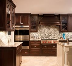 A white kitchen island & floor adds contrast to this darker traditional ktichen