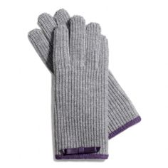 The Knit Bow Glove from Coach  Gotta keep the hands warm this winter. These will work.