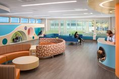 HCD Mag - UC Davis Children's Surgery Center - the waiting rooms are designed with play in mind, with circular cut-outs that provide places for children to play and climb while they are waiting to be seen.