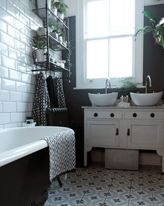 Black & white monochrome bathroom with pattered floor tiles, dark walls, white metro tiles with dark grout a claw foot bath tub and an upcycled wash stand Dark Green Bathrooms, White Bathroom Tiles, Bathroom Kids, Bathroom Storage, Bathroom Plants, Victorian Bathroom, Vintage Bathrooms, Black And White Tiles, Black White