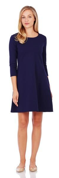 The Ava is a feminine swing dress in a stretch ponte fabric for cooler temps. Shop this fresh dress style in a classic midnight navy.