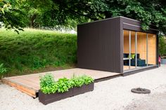 A Backyard Room: Kenjo Outdoor Cottage | another great idea for the backyard. Love that the porch / deck slides.