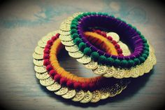 for a pair ***We also accept bulk orders*** This bangle is full of colorful velvet balls and traditional coins Silk Thread Bangles, Thread Jewellery, Beaded Jewellery, Silver Jewellery, Bangles Making, Jewellery Making, Saree Tassels, Oxidised Jewellery, India Jewelry