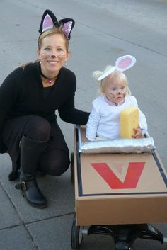Cat and mouse in trap costume. Made from cardboard, dryer vent, plastic pvc pipe, and placed over a wagon.