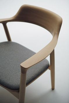 Chair for each end of dining table in black leather. Hiroshima by Naoto Fukasawa for Maruni #ChairDesign