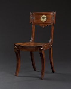date unspecified Set English Regency chairs. At the center of the backrest, the arms of Talbot of Devon is illustrated. The talbot is an now-extinct white hunting dog, believed to have originated in Normandy or England, often used in heraldry. Regency Furniture, Art Deco Furniture, Cheap Furniture, Wood Furniture, Vintage Furniture, English Antique Furniture, Antique Chairs, Side Chairs, Hall Chairs