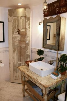 In this image released by Kelley & Company Home Design, a bathroom vanity and storage cabinet, made from made of a  repurposed table and door is shown in a design by Kelley Motschenbacher. (AP Photo/Kelley & Company Home Design)