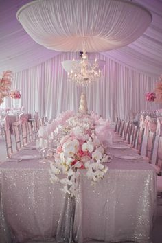 Love the glitter table cloth and ceiling decor!