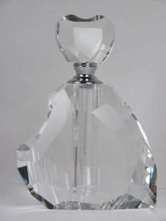 Crystal Perfume Bottle Oleg Cassini Heart Shaped Amore by Oleg Cassini http://www.amazon.com/dp/B00AVZMHQE/ref=cm_sw_r_pi_dp_3zSorb0NSFZFD