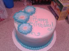 Blue ombre cake topped with fondant vintage ruffle flowers