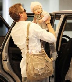 The original pinner talked about the diaper bag.  I'm too distracted by the hot daddy to even see a diaper bag.