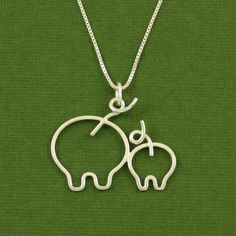 STOP IT! too cute!  Pig Necklace $62.00 via Etsy