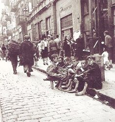 A street in the Warsaw ghetto - the biggest ghetto in the Poland, with almost half a million Jews. By the end of 1941 most Polish Jews had been moved into ghettos. The Warsaw ghetto was also used to temporarily imprison Jews deported from other countries on the way to the death camps.
