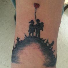 Banksy art tattoo boy meets girl
