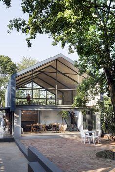 A Conference Room and Café from Refurbished Pretoria House https://www.futuristarchitecture.com/36799-conference-room-cafe-refurbished-pretoria-house.html