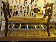 Score: Two broken old chairs, some scrap wood, paint and a home-sewn cushion will make a new stylish bench.