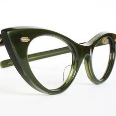 Cat Eye Glasses - I had black frames like this.  OMG