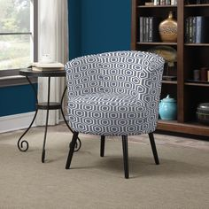 The Portfolio Home Furnishings Mariel casual barrel arm chair will add style to your decor. The Mariel chair features flared arms and soft curves and is covered in a geometric design fabric.