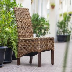 $215 for 2 chairs & free shipping on overstock.com.    International Caravan 'Manila' Woven Abaca/ Rattan Wicker Dining Chairs with Mahogany Hardwood Frame (Set of 2)