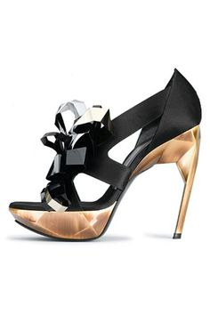 Black and gold Roger Vivier. how amazing is that structural heel