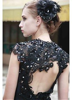 Beadwork on black V-neck lace back