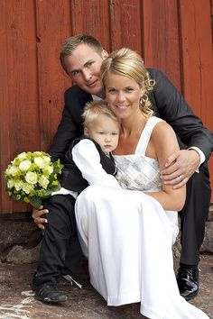 Bride and groom with son by Jenny