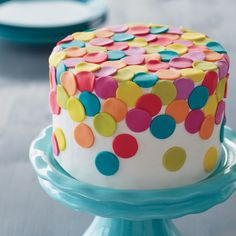 Decorating with fondant doesn't have to be complicated. With this Color Me Happy Fondant Cake, you can create a fun and bright 2-layer cake bursting with fondant decorations.