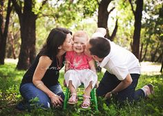 Cute family of three photo  Gma has a little rocking chair we could borrow for something like this. Oh! Gmas backyard? vines of the fence, grass, old fence? maybe...