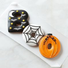 """Giant Boo Cookies: Put your frosting skills to the test with these big """"BOO!"""" cookies as your inspiration. A pumpkin, spiderweb, and moonlit sky filled with bats make for spooky sweet treats.  Source: Williams-Sonoma"""