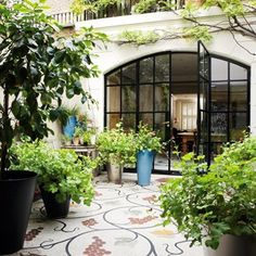 Interior designer Chester Jones complemented the mosaic floor in the kitchen to the courtyard outside.