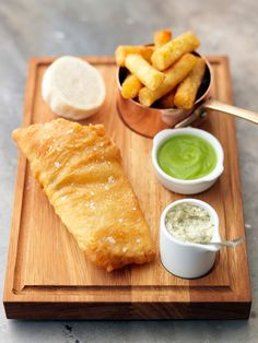 Fish and chips from the Tom Kerridge's Hand & Flowers in Marlow. Fried cod, mushy peas & hand cut chips.