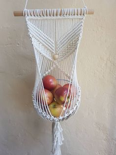 This is my signature design Macrame Plant Hanger/Fruit Bowl Hanger featuring natural wooden beads. Its a versatile piece for the macrame lover - use it for jewellery, mail, bibs n bobs, whatever you want! This piece which I designed is truly eye catching and unique, a piece you will