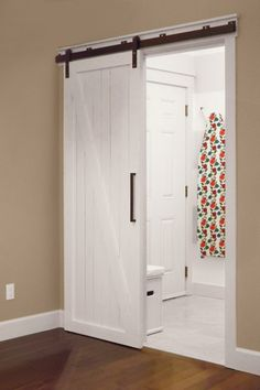 beige painted hall with white sliding barn door, pantone sand color of the month july 2014