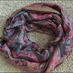 """Multicolor Paisley Scarf Beautiful multicolor paisley patterned scarf. Gorgeous colors lays well with any tie positions and it can be worn with many outfits. Fabric feels soft and sturdy. It is wide and long enough to wear over your shoulders or around. 26.5"""" width, 68"""" length. Like new condition. Accessories Scarves & Wraps"""