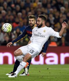"Barcelona's defender Gerard Pique (L) vies with Real Madrid's defender Dani Carvajal during the Spanish league ""Clasico"" football match FC Barcelona vs Real Madrid CF at the Camp Nou stadium in Barcelona on April 2, 2016."