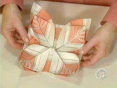 Martha shows some napkin folding ideas.