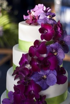 This five tier stacked wedding cake was stunning.  Fresh lilac & purple orchids cascaded down the entire cake by Barbados Weddings... beyond your imagination!!   'Pin it' if you love these orchids!http://barbadosweddings.com
