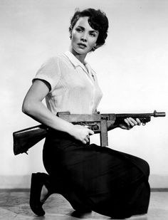 Jennifer Jones holding a prop M1928 Thompson submachine gun in a promotional still for WE WERE STRANGERS (1949)