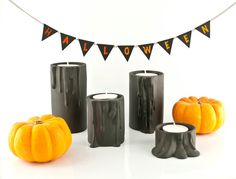 Handmade black ceramic candle holders have simple shape of cylinder and are decorated with extremly natural looking melting drops. With them